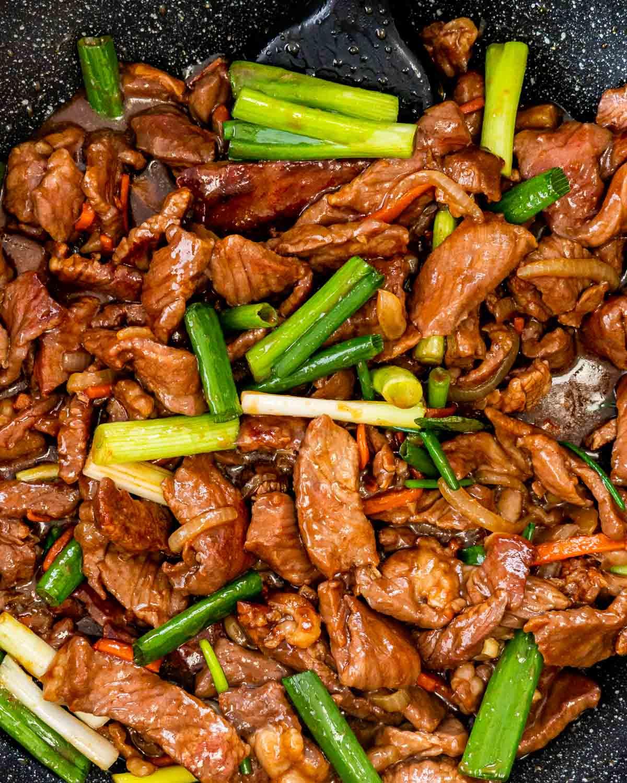 closeup of korean beef stir fry in a wok.