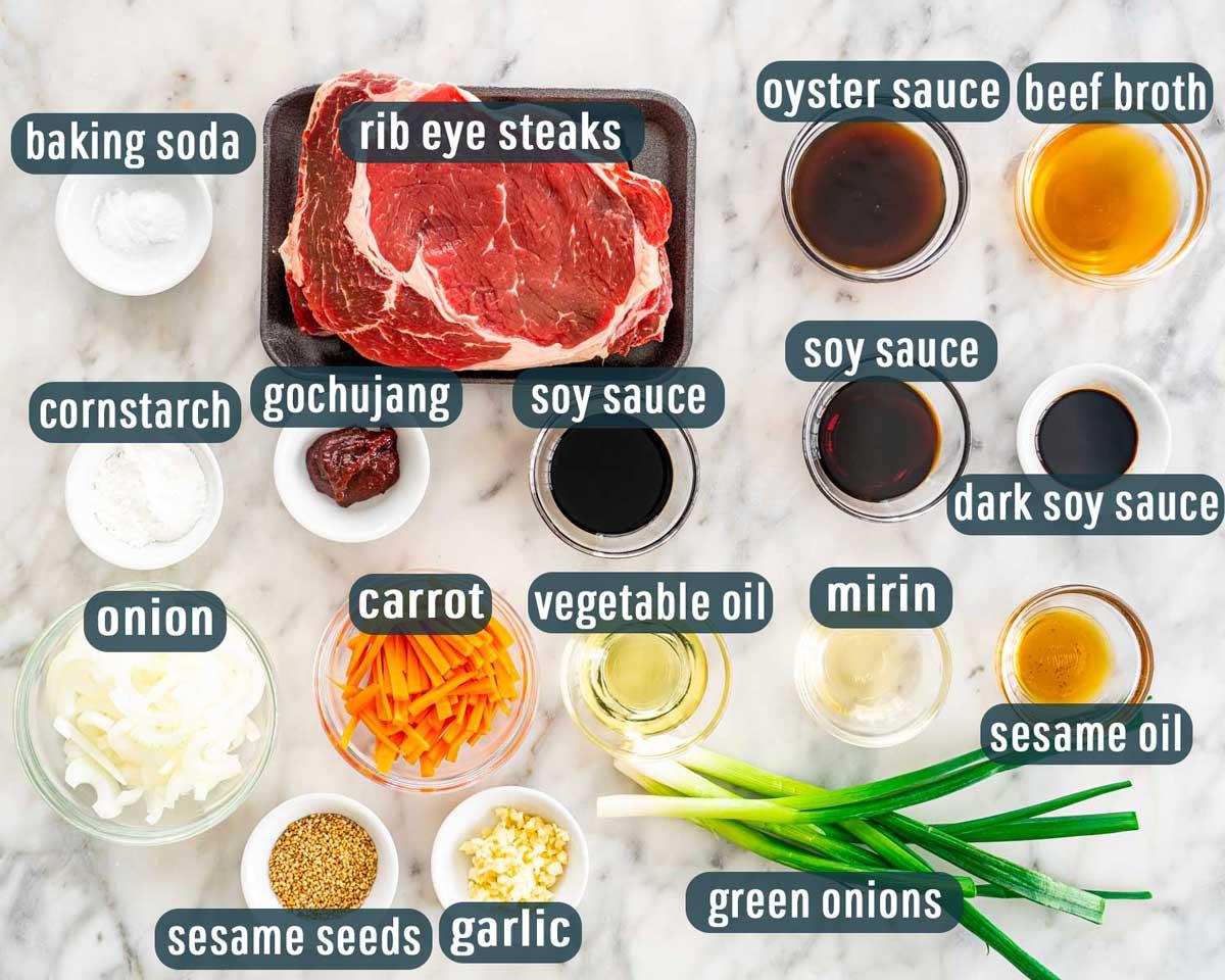overhead shot of all the ingredients needed to make korean beef stir fry.