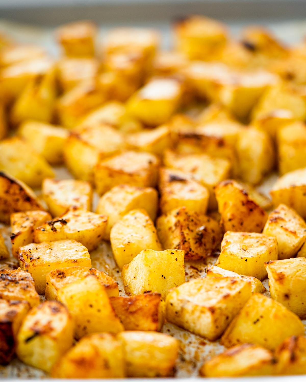 closeup of sweet potatoes on a baking sheet.