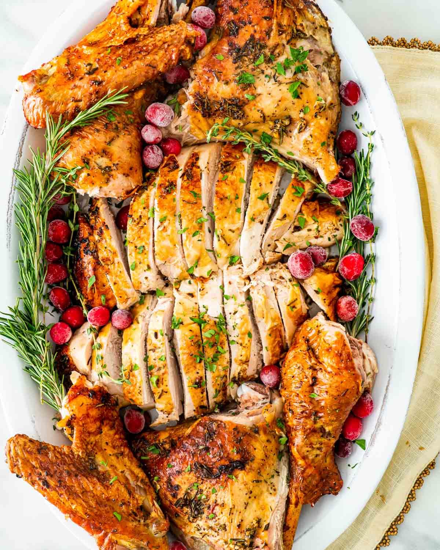 overhead shot of carved turkey on a platter.