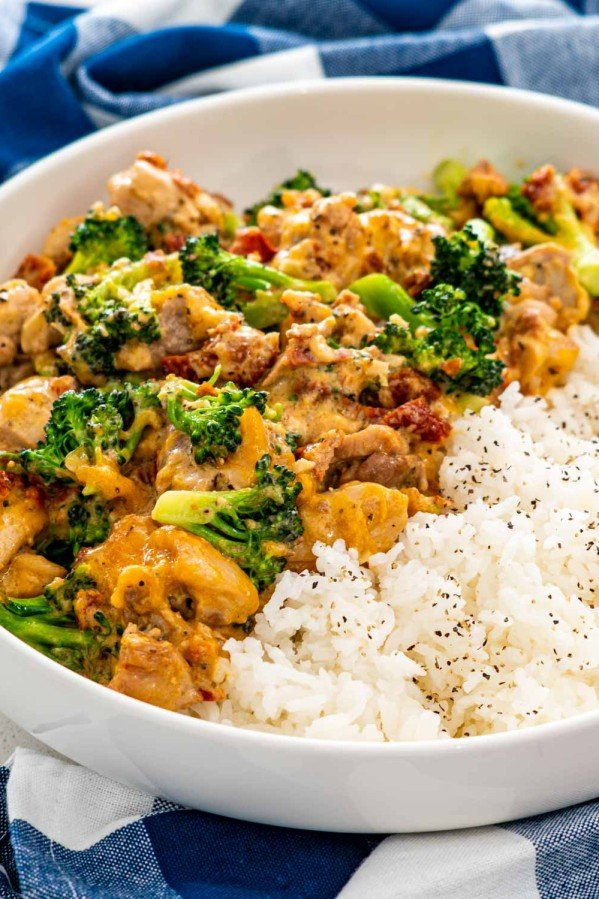 chicken broccoli with rice in a white bowl.