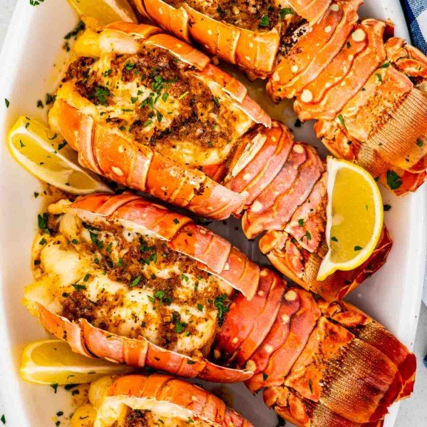 lobster tails on a white serving platter.