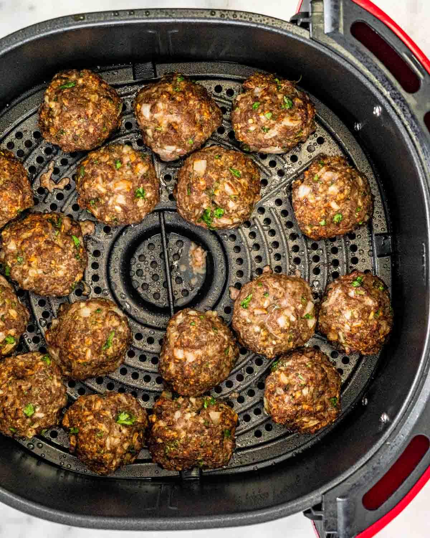 overhead shot of meatballs in an air fryer basket.