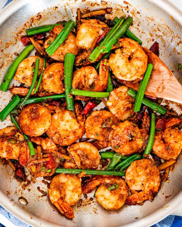 freshly made szechuan chili shrimp in a skillet.