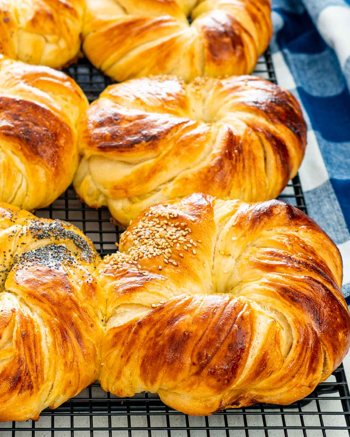 closeup of brioche buns cooling on a cooling rack.
