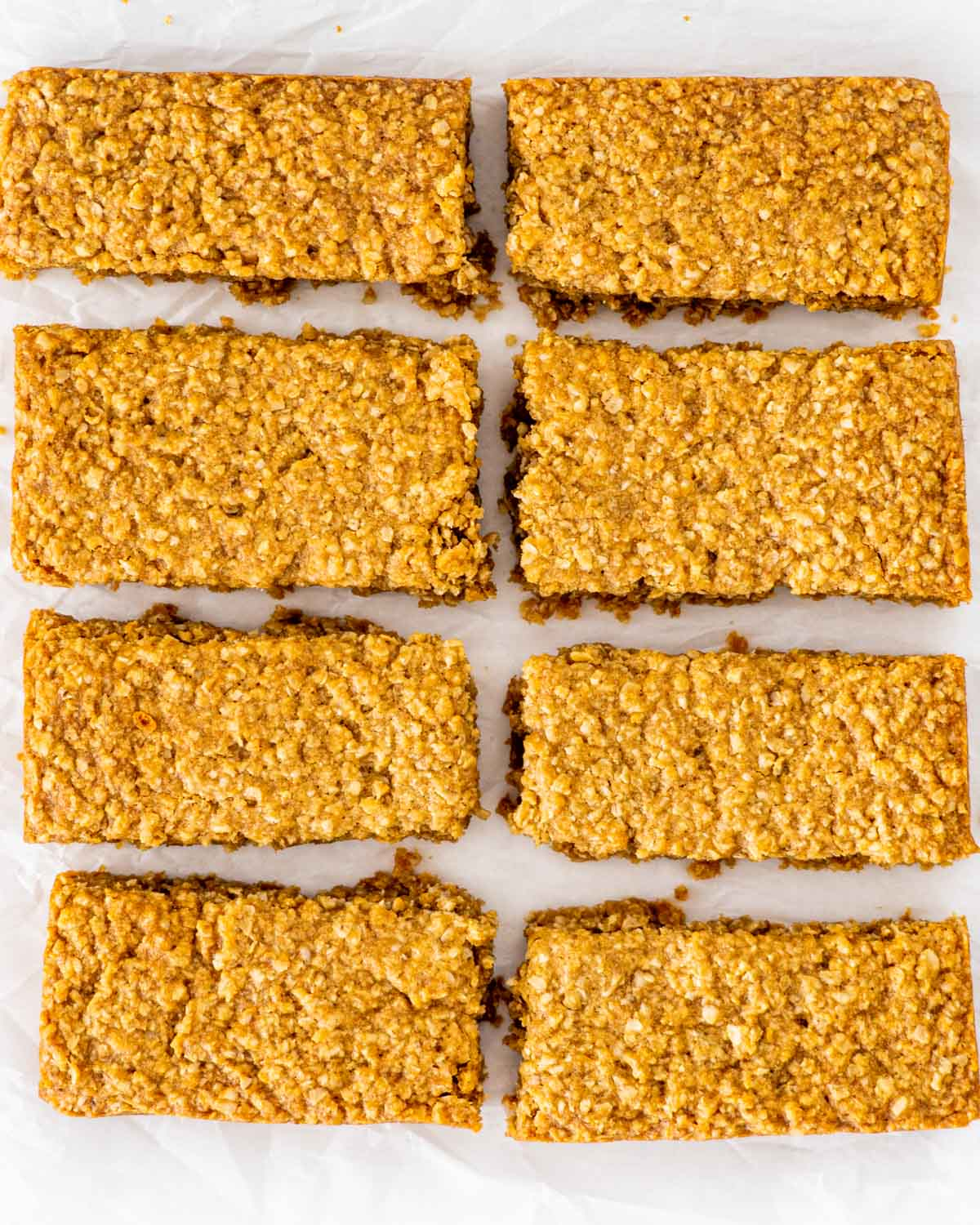 cut up bars of oatcakes on parchment paper.