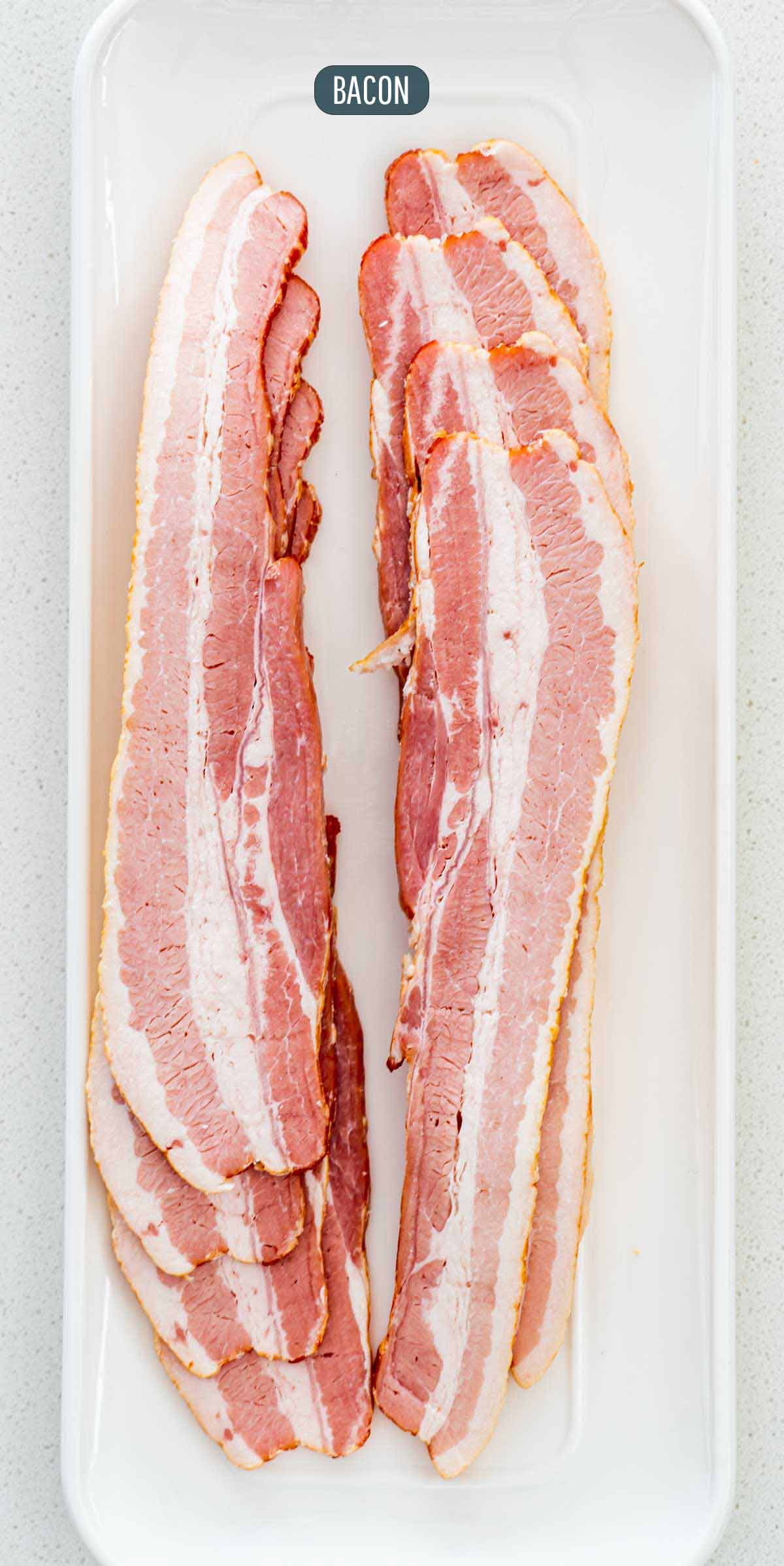 a long plate with strips of bacon on it.