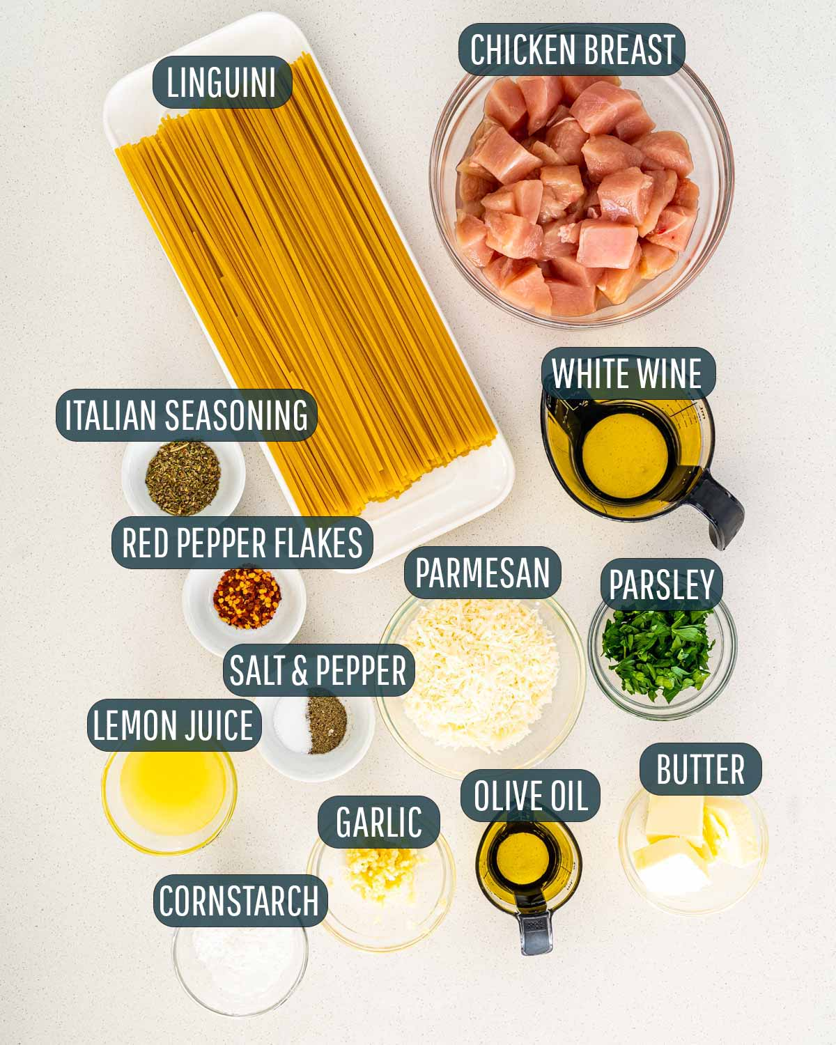 overhead shot of all the ingredients needed to make chicken scampi.