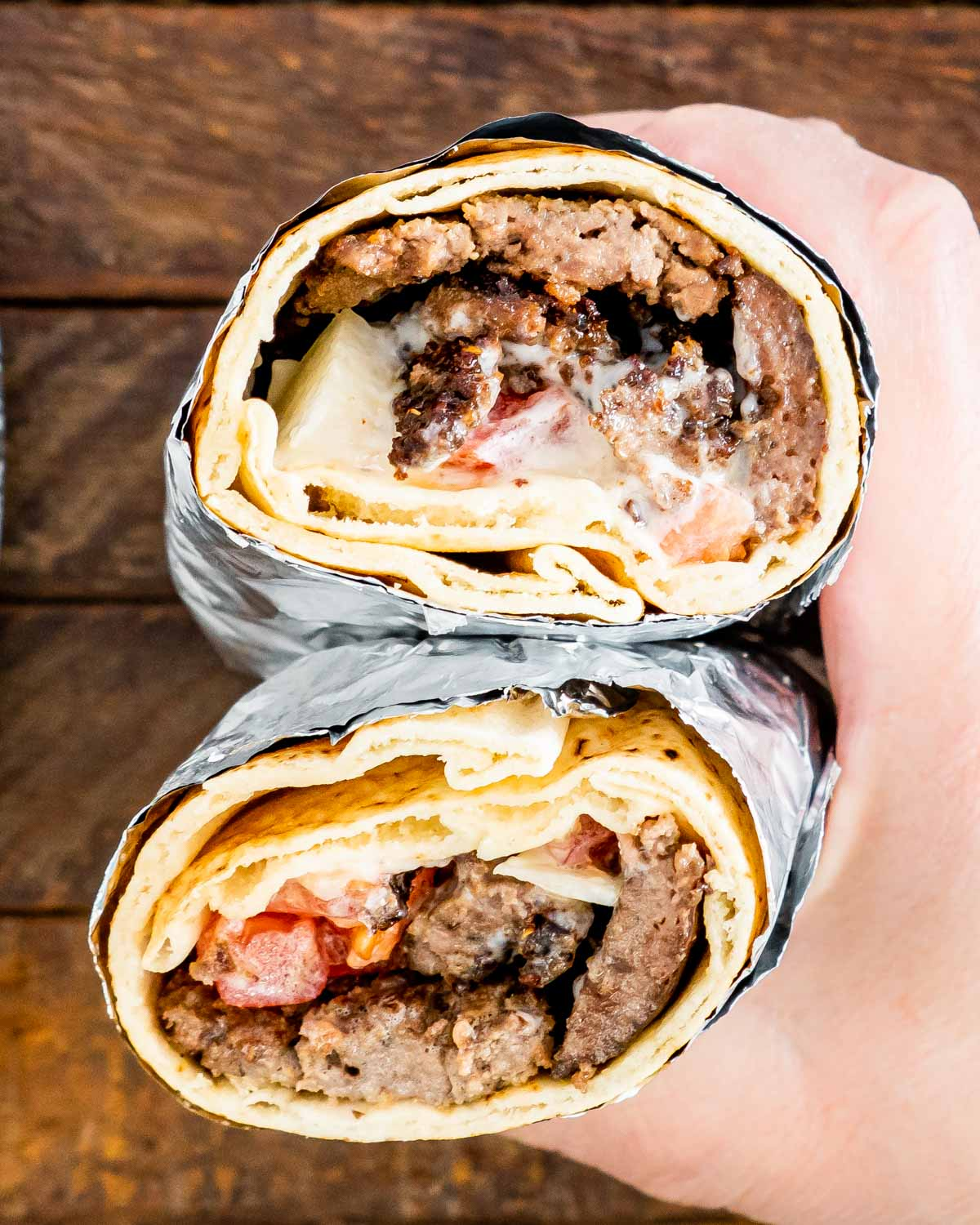two halves of halifax donair held in a hand.