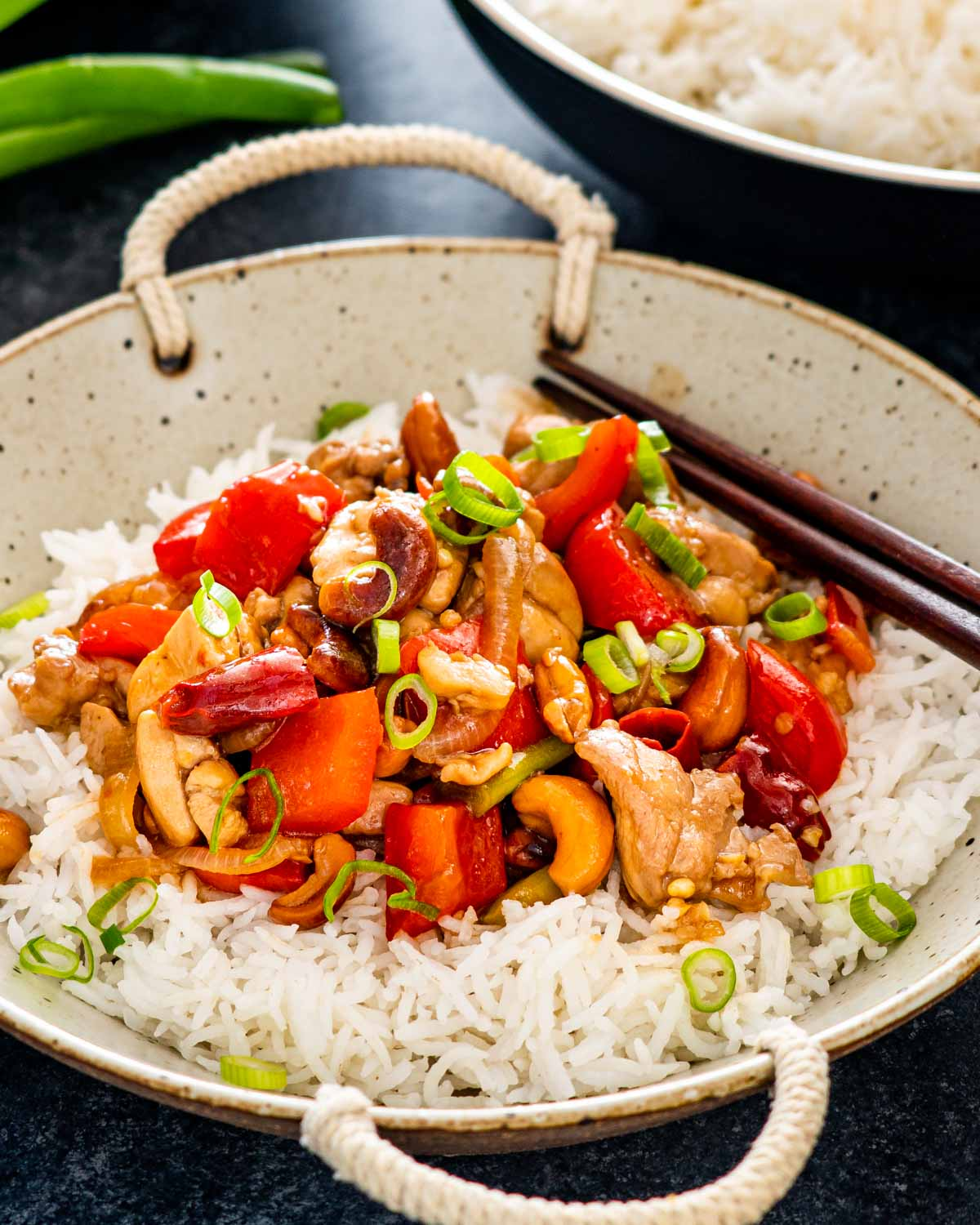 thai cashew chicken over a bed of rice.