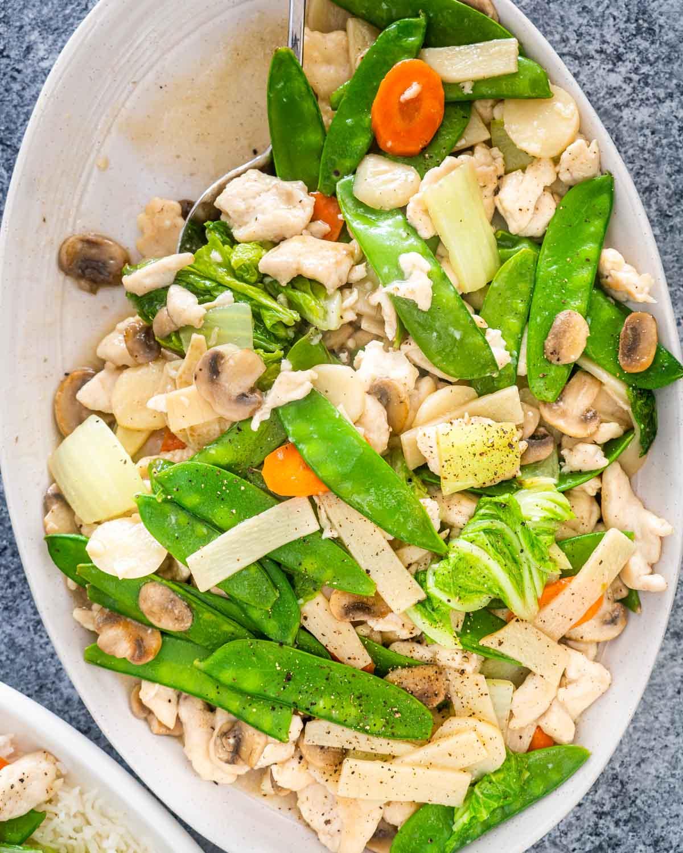 freshly made moo goo gai pan in a serving platter.