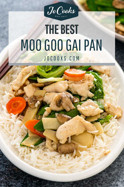 moo goo gai pan over rice on a white plate.