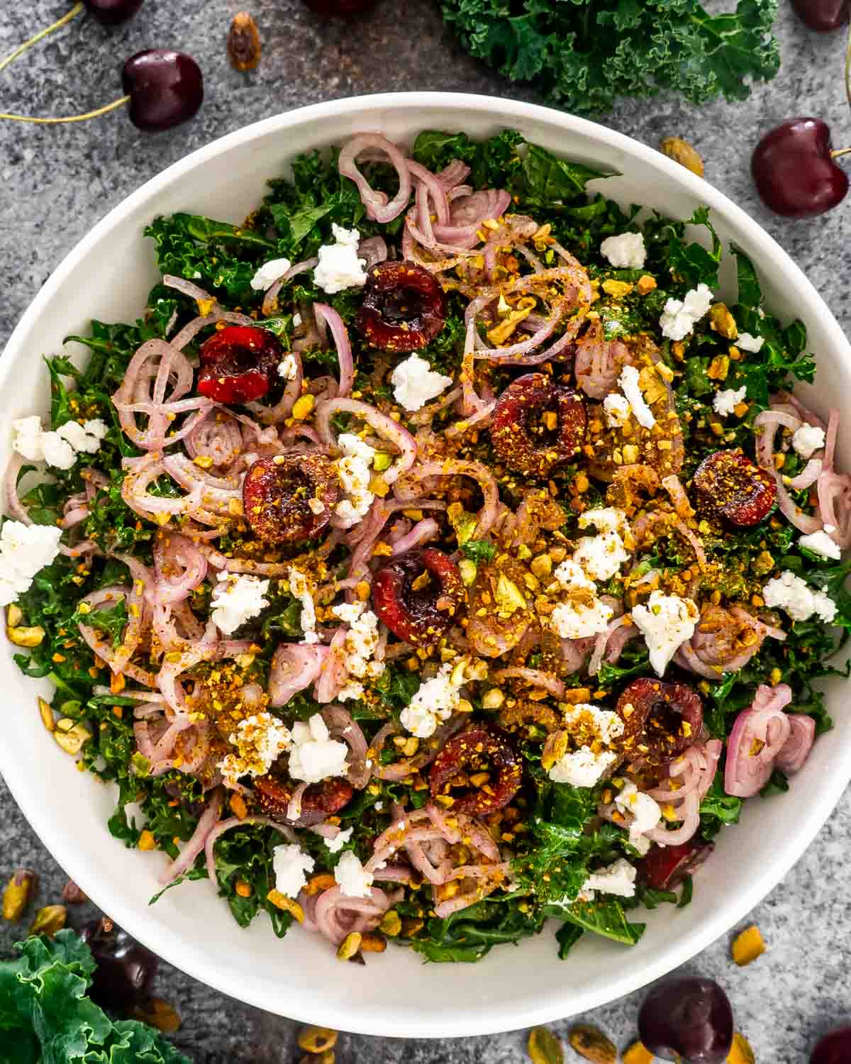 kale cherry salad in a white bowl.