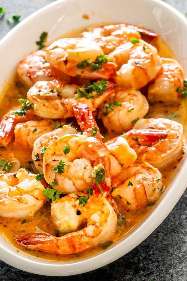 garlic butter shrimp in a white platter.